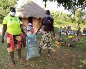 Widows in Sawagongo receiving fertiliser and masks